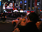 Kissing under a photo of President-elect Barack Obama on election day early Wednesday, Nov. 5, 2008  at Times square in New York. Photo by Eyal Warshavsky .