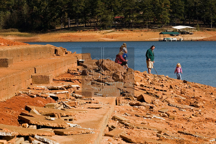 A family near the now-exposed grandstands of a submerged race track on Lake Lanier. The lake provides water for parts of Georgia, Alabama and Florida.