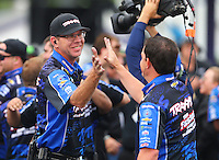 May 1, 2016; Baytown, TX, USA; Crew members for NHRA funny car driver Courtney Force celebrate after winning the Spring Nationals at Royal Purple Raceway. Mandatory Credit: Mark J. Rebilas-USA TODAY Sports