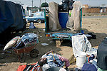 REIGER PARK, SOUTH AFRICA - MAY 23: A child rests while her parents packs the family belongings on May 23, 2008 at the Ramaphosa squatter camp outside Johannesburg, South Africa. Locals chased out African immigrant in the area and many shacks were burned down during xenophobic attacks in the township. A man was burned alive down the street and thousands of people fled to a nearby police station for safety. The family is traveling back to Mozambique, their home country. (Photo by: Per-Anders Pettersson/Getty Images)..