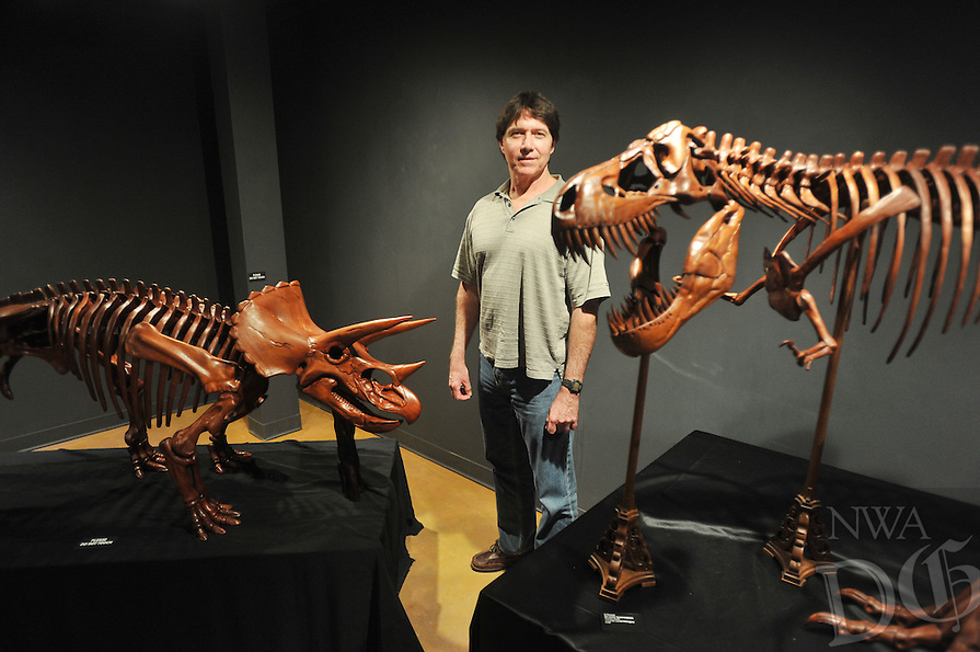 NWA Democrat-Gazette/MICHAEL WOODS &bull; @NWAMICHAELW<br /> Brent Smith of Siloam Springs stands with some of his mahogany carved dinosaur skeletons on display at the Fayetteville Underground. October 1, 2015.