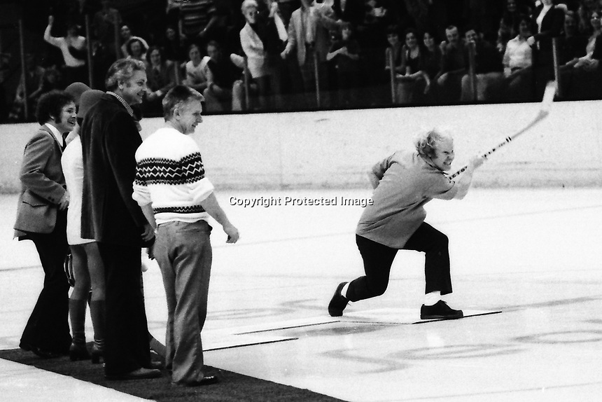 """Crazy George"" takes a shot on goal during periods of the California Golden Seals vs Detroit Red Wings hockey game at the Oakland Alameda County Coliseum Arena. (1974 photo/Ron Riesterer)"