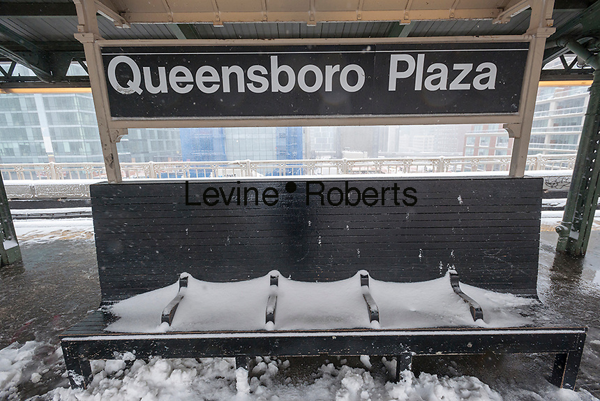 A snow-covered bench in the Queensboro Plaza station in New York during the city's first major winter storm of the season on Thursday, February 9, 2017. Meteorologists are forecasting between 8 and 14 inches of snow in the New York City region. The Metropolitan Transportation Authority has had no major delays and the trains continue to run.  (© Richard B. Levine)