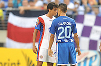 Yelstin Tejeda (17) of Costa RIca at argues with Jorge Claros (20) of Honduras after a hard tackle. Honduras defeated Costa Rica 1-0 at the quaterfinal game of the Concacaf Gold Cup, M&T Stadium, Sunday July 21 , 2013.