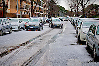 A sudden hailstorm hit the Cinecittà neighborhood, making the road surface white as if there was snow. Rome, Italy. 3th March, 2016.