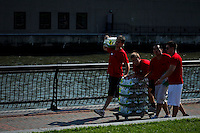 People pull a wagon with water to be donated in a private event for kids at the hoboken area during a heat advisory around New York, July 17, 2012. The National Weather Service predicts highs around 95 on Tuesday, Local Media reported.  Eduardo Munoz Alvarez / VIEW.