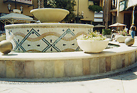 Custom Diamond Weave mosaic outdoor fountain shown in Verde Luna, Verde Alpi, Botticino, Giallo Reale, and Rosa Verona.