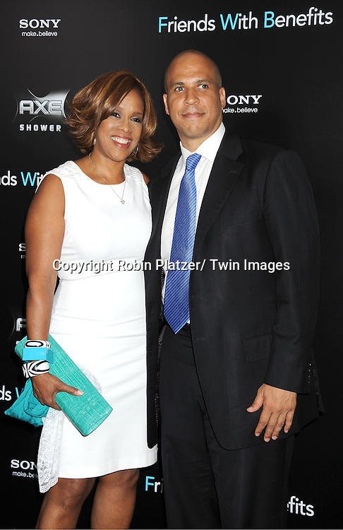 """Gayle King and Cory Booker attending the New York Premiere of """"Freinds With Benefits"""" on July 18, 2011 at The Ziegfeld Theatre in New York City. The movie stars Justin Timberlake, Mila Kunis, Emma Stone, Patricia Clarkson, Jenna Elfman and Bryan Greenberg."""