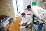 Shawn McNulty, Ph.D. (left), inspects a lab with Research Assistant James Krehling in the Poultry Science building at Auburn University in Alabama November 18, 2009. McNulty is the Assistant Biosafety Officer for the Risk Management and Safety Department at Auburn.