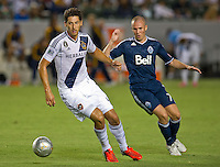 CARSON, CA - September 1, 2012: LA Galaxy defender Omar Gonzalez (4) and Vancouver forward Kenny Miller (7) during the LA Galaxy vs the Vancouver Whitecaps FC at the Home Depot Center in Carson, California. Final score LA Galaxy 2, Vancouver Whitecaps FC 0.