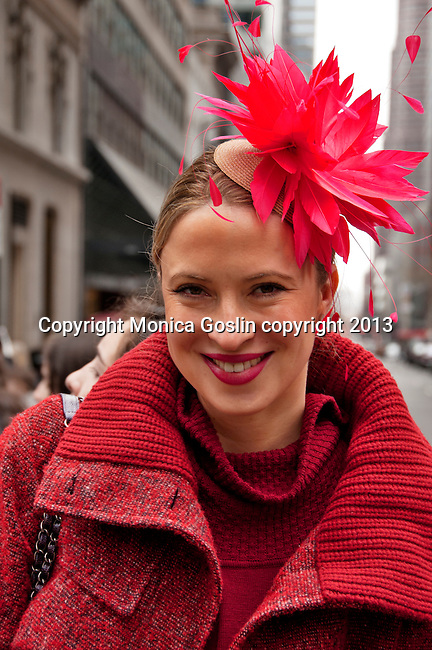 A woman wears a red feathered hat to the Easter Parade in New York City on Fifth Avenue