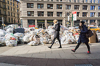 Bags of trash await pick-up in the Flatiron neighborhood of New York on Saturday, January 30, 2016. As the snow melts from out recent storm the Dept. of Sanitation is starting to resume trash collection.  (© Richard B. Levine)