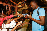 Usain Bolt signing autographs for his young fans at the National Stadium after his blazing 9.76sec. 100m victory at the Jamaica International Invitational Meet on Saurday, May 3rd. 2008. Photo by Errol Anderson, The Sporting Image.