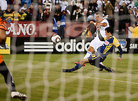 Cristiano Ronaldo kicks the ball against Trevino Patricio. Real Madrid defeated Club America 3-2 at Candlestick Park in San Francisco, California on August 4th, 2010.