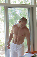 shirtless sexy man at home in The Hamptons