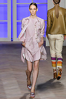 Zuzanna Bijoch walks the runway in a pink/white striped silk jean jacket, pink/white multi-striped cotton sleeveless button-down shirtdress with shirttail hem and pleated skirt, by Tommy Hilfiger for the Tommy Hilfiger Spring 2012 Pop Prep Collection, during Mercedes-Benz Fashion Week Spring 2012.