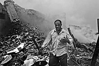 Baghdad, Iraq, April 7, 2003.A man looking for unlikely survivors from his family on the site where a massive US bomb completely destroyed 4 houses and damaged the whole area in Al Mansour, killing at least 20 civilians and leaving a crater 15 meters deep and 25 meters across. Local rumors said the Americans tried to hit a key figure of the regime hiding there, possibly Kusai, the youngest son of President Saddam Hussein.