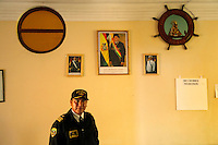 Captan Juan Rosas stands in the Tiquina Naval Base, on Lake Titicaca on the day they mourn the loss of their ocean to Chile in the War of the Pacific, in Tiquina, Bolivia, in March, 2011.  Bolivia lost what is now northern Chile in a war over nitrates leaving Bolivia without access to the ocean.