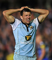 Vasily Artemyev grimaces during a break in play. Aviva Premiership match, between Bath Rugby and Northampton Saints on September 14, 2012 at the Recreation Ground in Bath, England. Photo by: Patrick Khachfe / Onside Images