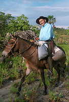 Caipira man (peasant man from rural areas of central Brazil) riding a mule in the savanna (cerrado in Brazil) in the Brazilian Highlands.