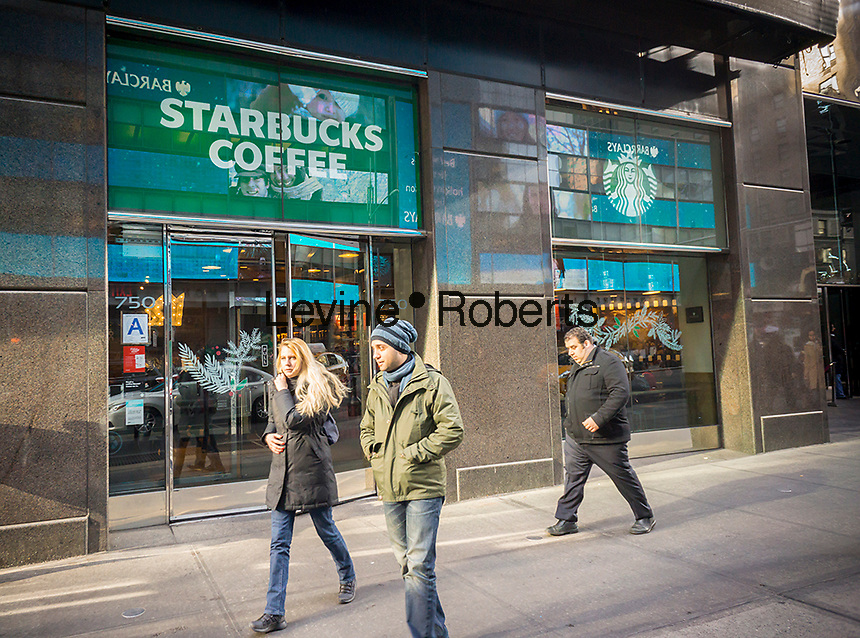 Exterior of a Starbucks during the first day of the Starbucks Cheer promotional event in New York on Friday, December 23, 2016. For the next 10 days, excluding Christmas, Starbucks is giving away a tall espresso drink of your choice between the hours 1 and 2PM at a rotating choice of 100 stores around the country. (© Richard B. Levine)