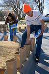 Coronado High School students prepare luminarias for Christmas Eve on Pennsylvania Circle, El Paso, Texas.