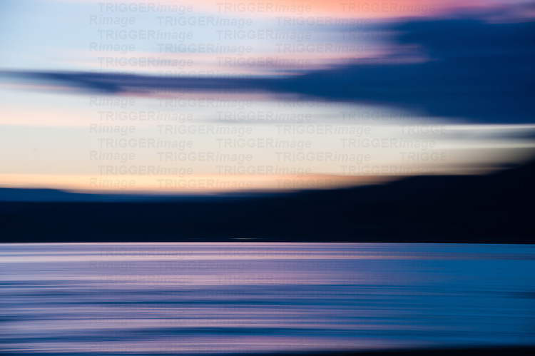 Sunset and blue hour panned with smooth lines of ocean and clouds.