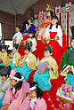 Kindergarten children in traditional costumes pose on a platform for 'Hinamatsuri' or doll festival at a kindergarten in Tokyo. Hinamatsuri is celebrated on March 3, which is known as Girls' Day, in Japan.  27 February, 2009. (Taro Fujimoto/JapanToday/Nippon News)