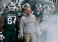 Michigan State Spartans head coach Mark Dantonio leads his team onto the field prior to the NCAA football game against the Ohio State Buckeyes at Spartan Stadium in East Lansing, Mich. on Nov. 19, 2016. Ohio State won 17-16. (Adam Cairns / The Columbus Dispatch)