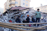 VAN, TURKEY: Earthquake survivors sit in a house that's been reduced to rubble...On October 23, 2011, a 7.2 magnitude earthquake hit eastern Turkey killing over 250 people and wounding over a thousand...Photo by Ali Arkady/Metrography