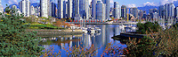 """City of Vancouver Skyline and Downtown at Yaletown and """"False Creek"""", British Columbia, Canada, in Autumn / Fall.  Granville Island is in the left foreground, and the North Shore Mountains (Coast Mountains) rise above the City. - Panoramic View"""