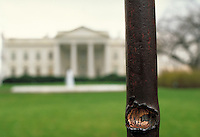 bullet impact on fence outside The White House