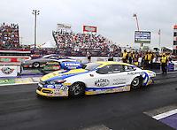 Apr 27, 2014; Baytown, TX, USA; NHRA pro stock driver Allen Johnson (near lane) races alongside Vincent Nobile during the Spring Nationals at Royal Purple Raceway. Mandatory Credit: Mark J. Rebilas-