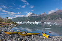 Kayaks on a beach in Bear Glacier Lagoon, Kenai Fjords National Park, southcentral, Alaska.