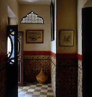 This hallway has a pierced fretwork window and double doors with coloured glass panels bought in the local souk
