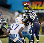 Tennessee Titans'  guard Steve Hutchinson (73) pass blocks iSeattle Seahawks' Jaye Howard (94) n a pre-season game at CenturyLink Field in Seattle, Washington on August 11, 2012. 2012. Jim Bryant Photo. All Rights Reserved...