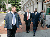 Atlanta Falcons quarterback Michael Vick is escorted by federal marshals and his attorneys as he leaves federal court  after pleading guilty in a dogfighting case in Richmond, Va., Monday, Aug. 27, 2007.  (AP Photo/Steve Helber/POOL)