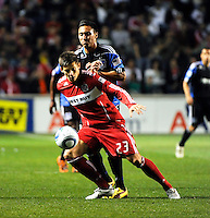 The Chicago Fire's Krzysztof Krol (23) shield San Jose forward Arturo Alvarez (10) from the ball during the second half of a match between the San Jose Earthquakes and the Chicago Fire at Toyota Park in Bridgeview, IL on April 10, 2010.  San Jose Earthquakes 2, Chicago Fire 1.