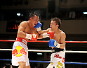 (L-R) Pornsawan Porpramook (THA), Akira Yaegashi (JPN), OCTOBER 24, 2011 - Boxing : Akira Yaegashi of Japan hits Pornsawan Porpramook of Thailand during the tenth round of the WBA minimumweight title bout at Korakuen Hall in Tokyo, Japan. (Photo by Mikio Nakai/AFLO)