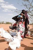 Kenya - Dadaab - Somali refugees waiting for food distribution.