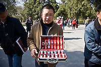 Watch seller in park of the Temple of Heaven, Beijing, China