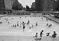 August 1971, Harlem, New York City, New York State, USA --- People cool off in the local neighborhood swimming pool, near the North of Central Park. --- Image by © JP Laffont/Sygma/Corbis