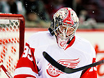 21 November 2009: Detroit Red Wings' goaltender Jimmy Howard catches one on his mask during pre-game warm-ups prior to facing the Montreal Canadiens at the Bell Centre in Montreal, Quebec, Canada. The Canadiens, wearing their original season 1909-10 throwback uniforms fell to the visiting Red Wings in a 3-2 shootout. Mandatory Credit: Ed Wolfstein Photo