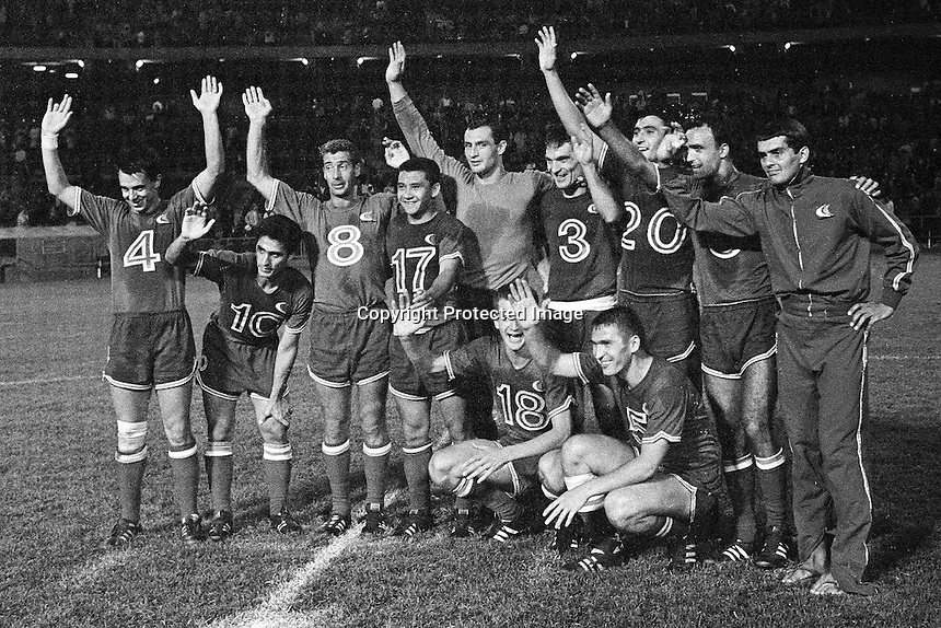 Oakland Clippers soccer team (1967), (L-R) Llija Mitic, William Quiros. Ademar Saccone, George Lievano, goalie Mirko Stojanovic, Dimitrjic Davidovic, Momcilo Gavric, Milan Cop, Dragan Djukic, Melvyn Scott, (unidentified in sweat suit)..team pose for photo after winning the Championship at the Oakland Alameda County Coliseum, (Aug 16,1967) (photo by Ron Riesterer)<br />(photo by Ron Riesterer)