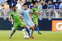 James Riley (7) defender Seattle Sounders shields the ball from Jeferson (10)  midfielder Sporting KC,.. Sporting Kansas City were defeated 1-2 by Seattle Sounders at LIVESTRONG Sporting Park, Kansas City, Kansas.