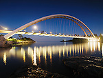 The Humber River Arch Bridge in Toronto at night also known as the Humber Bay Arch Bridge or the Gateway Bridge. Toronto, Ontario, Canada.