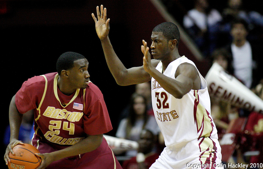 TALLAHASSEE, FL 2/14/10-FSU-BC BB10 CH10-Florida State's Solomon Alabi, right, defends Boston College's Evan Ravenel during first half action Sunday at the Donald L. Tucker Center in Tallahassee. The Seminoles beat the Eagles 62-47...COLIN HACKLEY PHOTO