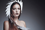 Caucasian female model wearing unusual white headdress