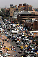Congested early morning traffic blocks Sharia Pasha al Mek, a main thoroughfare in Souq Al-Arabi in central Khartoum.