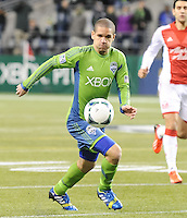 November, 2013: CenturyLink Field, Seattle, Washington: Seattle Sounders FC midfielder Osvaldo Alonso (6) pursues the ball  as the Portland Timbers defeat  the Seattle Sounders FC 2-1 in the Major League Soccer Playoffs semifinals Round.
